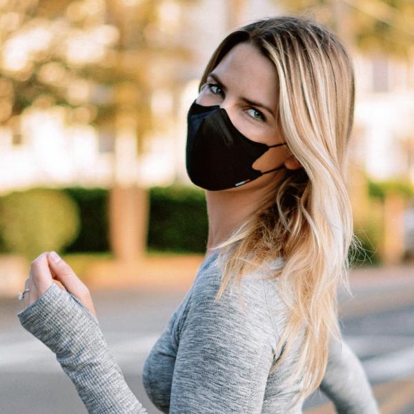 SilverTek NanoFit Mask on a blonde woman jogging outside